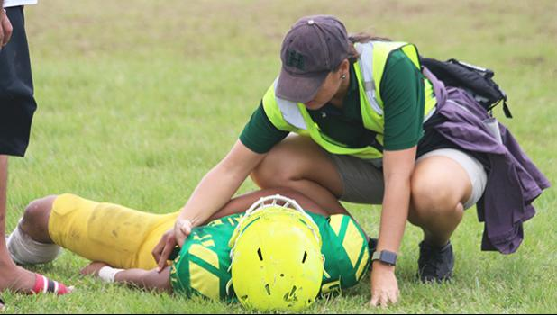 ASHSAA/JPS ATC Florence Wasko tending to an injured Leone Lion