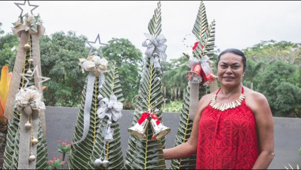 SAMOA'S OWN: Louise Main combines her love for nature and her keenness to create beautiful arts and crafts to produce striking decorative pieces and recently her take on the Christmas tree where she used palm fronds has been a hit. (Photo: Misiona Simo)