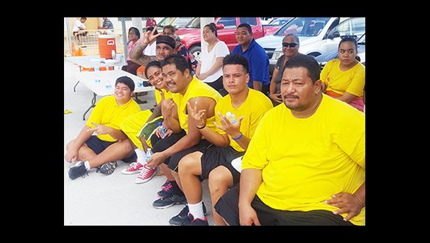 Members of the yellow team for the open division of the Manumalo Church Basketball Fellowship League kicked off last month and concluded on Saturday. [Courtesy photo]