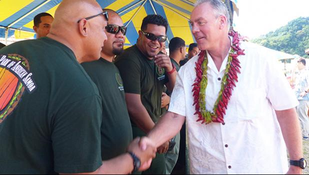 Sec. Zinke shaking hands with American Samoa firefighters