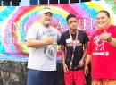Samoana HS principal Rod Atafua with Special Education teacher Mafutaga Taase and SPED student DeAndre Chen