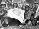 Trophy: U.S. troops hold a Japanese flag captured in July 1944 during the Battle of Saipan
