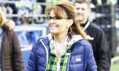 In a Thursday, Dec. 15, 2016 file photo, Sarah Palin, political commentator and former governor of Alaska, walks on the sideline before an NFL football game between the Seattle Seahawks and the Los Angeles Rams, in Seattle. Palin's spokesman told The Associated Press on May 11, 2017, that reports that she was in a coma following a car accident are not true. (AP Photo/Scott Eklund, File)