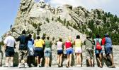 "n this July 21, 2005 file photo, visitors watch while workers pressure wash the granite faces of George Washington, left, Thomas Jefferson, Theodore Roosevelt and Abraham Lincoln at Mount Rushmore National Memorial in South Dakota. The Democracy Index, compiled by the London-based Economist Intelligence Unit, ranked the U.S. at 21st worldwide in 2016, tied with Italy and trailing Norway, Canada and Uruguay, among others. While Norway and several other Scandinavian countries are considered ""full democracies,"