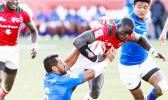 Neria Fomai #6 and Laaloi Leilua #7 of Samoa combine to bring down Andrew Amonde #8 of Kenya during the Trophy Cup Final match between Kenya and Samoa at the HSBC Rugby Sevens Series held in Sam Boyd Stadium March 3-5, 2017. Final score: Kenya- 21, Samoa-14. (Photo by Allan Hamilton/ Calibre Sports Photomedia)