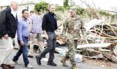 President Trump walks with FEMA administrator Brock Long (second from right) and Lt. Gen. Jeff Buchanan (right) as he tours an area affected by Hurricane Maria in Guaynabo, Puerto Rico, on Oct. 3. [Evan Vucci / AP]