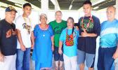 In this photo are the two young boxers at the airport with their families this past Monday as they prepared to leave for their training camp.  [Photo: EM]