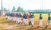Australia (left) defeated American Samoa 15-0 during the opening match of the U12 Oceania Baseball Championship in Guam yesterday. According to members of the AS Baseball team in Guam, it was a tough game for our young team but the kids did their best. American Samoa played Guam in the second match of the tournament, yesterday. [courtesy photo]