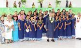 The American Samoa Women's U-16 team at the Leone Holy Cross Parish with Father Kelemete Pua'auli (far right), Fofo County Senator Faaivae Iuli Alex Godinet (2nd from left), and Sua County Senator Muagututia Tauoa (middle) on Sunday, July 30, 2017.  [FFAS MEDIA/Brian Vitiolio]