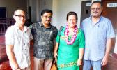 Following her guest speech at an ASCC faculty conovocation, DOE Director Dr. Ruth Matagi-Tofiga (second right) took a moment to chat with (l-r) student Ulelemaikalani Nate Kwon, science instructor Gopalan Murali and automotive instructor Fred Suisala.  [Photo: J. Kneubuhl]