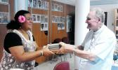 ASCC Samoan Studies Institute Director Mrs. Okenaisa Fauolo-Manila (left) receives a gift of books on the Tahitian language from Bishop Hubert Coppenrath of the Tahitian Academy during the recent Polynesian Festival hosted in Papeete by Te fare Tahiti Nui (also known as the Maison de la Culture).  [Photo: T. Mulitalo-Cheung]