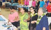 """A look at some of the members of the American Samoa delegation as they joined hands and sang """"Lota Nu'u"""", during the closing ceremony at last Friday's 7th Bilateral Health Summit of the two Samoas at Gov. H. Rex Lee Auditorium.  [photo: AF]"""