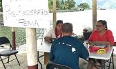 This recent photo shows ASG pre registration for residents impacted by Tropical Storm Gita, at the small fales outside of the DYWA Pago Pago Youth Center. This is for residents who missed the pre registration date at the village level.  [photo: FEMA]