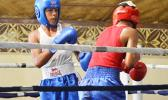 Karl Apelu (left) of Samoa against Mamona Tafa (right) of American Samoa during the first bout of the 2016 Mosooi International Boxing Championships last Saturday night at the Maliu Mai Resort in Fogagogo. Apelu won his bout in a unanimous decision. [photo by AF]