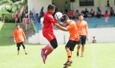 A Black Roses player, left, and Royal Puma opponent, right contest for the ball on Match Day 10 of the 2016 FFAS National League at Pago Park Soccer Stadium on Saturday, Oct. 29.  [FFAS MEDIA/Brian Vitolio]