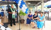 "Father Vaiula Kolio blessing the newly renovated Bluesky Communications store at the Laufou Shopping Center, yesterday morning. The inside of the store was 'blessed' with Holy Water — which the Catholic priest said, ""With the intention that all will be good in the name of our Lord.""  [photo: TG]"