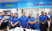 Bluesky Communication employees awaiting the end of the dedication ceremony to officially open their newly renovated store inside the Laufou Shopping Center yesterday morning. [photo: TG]