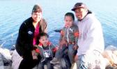 Aufanua Manusina, pictured here with his wife and two of his children, was deported to Samoa on Tuesday.  (Photo courtesy Sauelelee Manusina)