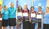 Four graduates were presented scholarships from Bluesky Communications yesterday at the company's main office at the Laufou Shopping Center. Three of the scholarships were for students accepted to off island schools and one for ASCC. The awardees are: Tedy Barber, Gabriella Langkilde, Farah Young, and Casidhe Mahuka.  [photo: Leua Aiono Frost]