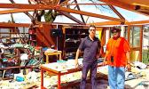 Paul Bayly (l) surveying the damage done by TC Winston with DS at RKS school library in Viti Levu, with one of his deputies Puamao Sowane (r).  [Courtesy photo]