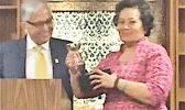 University of Guam president, Dr. Robert Underwood presenting Congresswoman Aumua Amata with the 2017 Distinguished Alumnus Award.  [photo: courtesy]