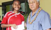 Elcy Lui, left, of Vaiala Tongan's 13-15 girls team receives her MVP award for the 2017 FFAS Summer Youth League from Sen. Faiivae Iuli Alex Godinet on July 15 at Pago Park Soccer Stadium.