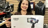 Ellen Elliott, of family owned/partnership Drone Services Hawaii, shares the DJI Osmo Mobile, a great family holiday gift, offering amazing professional results.  [Photo: Barry Markowitz]