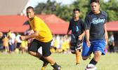 A Iakina Adventist Academy player dribbles by a Samoa Baptist opponent of the Boys Grades 6-8 division on Match Day 2 of the 2016 FFAS Private Elementary Schools soccer league at the Kanana Fou Seminary Field on Thursday, Oct. 20, 2016.  [FFAS MEDIA/Brian Vitolio]