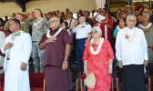 Front row, standing on stage at Veterans Memorial Stadium during the raising of the United States and American Samoa flags at Monday's 2017 Flag Day ceremony. [l-r] Catholic Deacon  Malaki A. Timu o le the Holy Family Parish Fatuoaiga, Chief Justice Michael Kruse and Masiofo Filifilia Tamasese with Samoa Head of State Tui Atua Tupua Tamasese Efi, who delivered the Flag Day keynote speech. [photo: AF] 0771