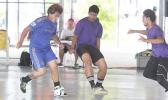 A Green Bay A player dribbles the ball as two PanSa opponents converge on him during Match Day 3 of the 2017 FFAS Futsal Tournament at Samoana High School's gym in Utulei on Saturday, May 20, 2017.  