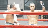 George Tanoa Jr. of American Samoa (right) raising his hand after winning his first professional fight — that was against veteran Tony Iapesa of Samoa in the heavyweight division during the American Samoa Flag Day 2017 Championship Boxing event for the All Samoan Light Heavyweight Title between the two Samoas last Saturday night at the old Bowling Alley in Tafuna [photo: AF]