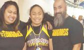 Goddess Ma'alona-Faletogo, a 14 –year-old Samoan girl — who was born blind — with her proud parents this past weekend at the Washington State Wrestling Championship in Washington, at the Tacoma Dome.  [Courtesy photo]