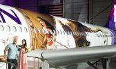 "Hawaiian Airlines revealed last Saturday the first of three ""Moana"" themed planes at its home base at Honolulu International Airport.  Pictured on the stairs are Auli'i Cravalho, the Hawaiʻi-born actress who is the voice of Disney's ""Moana,"" and Dwayne 'The Rock' Johnson, the voice of demigod Maui, and were among the first to see the new design. [Photo: Donald Traill for Hawaiian Air]"
