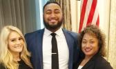 Asiata (center) is seen here with his mother (right) and wife (left). [courtesy photo]