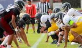 Nu'uuli Wildcats offensive unit facing the Warriors 'D' at the line of scrimmage during their JV match. Tafuna lost – their first loss of the season against the lowest seed of the division, Nu'uuli Wildcats 14 - 12. [photo: TG]