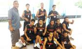 Coach Afati Afati with the Fagaitua Vikings JV Basketball team after losing against the Samoana Sharks JV on Tuesday evening.  [photo: Ese Malala]