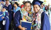 Two graduates of Kanana Fou High School smile proudly for the camera at the end of the commencement ceremony yesterday that was held at the CCCAS Taeaoafua Gymnasium. Congrats girls!   [photo:EM]