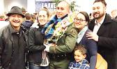 """Newly sworn-in Monterey County Deputy Sheriff, Tautaimatapala Anthony Langkilde with family members and a friend, following his graduation ceremony last month. A native of American Samoa, Langkilde is the son of Tamatoa Tony (far left) and the late Bernadette """"Pele"""" Scanlan. He was among the Dec. 17, 2017 graduates of the South Bay Regional Academy.  [photo: Langkilde family]"""