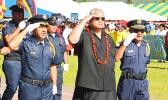 Deputy Police Commissioner Vaimaga Maiava, Police Commissioner Le'i Sonny Thompson and Deputy Commissioner Falana'ipupu Taase Sagapolutele, salute as they pass in front of the grandstand with the Department of Public Safety personnel in 'the pass in review' at yesterday's 2017 Flag Day ceremony, held at the Veterans Memorial Stadium.  Le'i has initiated a  a 'Drug Free Work Place Policy', which is set to take effect on May 1, 2017, in response to public and government concerns about allegations of illegal d