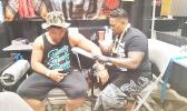 """Although it was his first time attending at the Northwest Tatau Festival in Washington state, Tahitian tattoo artist Makalio - originally from Wallis and Futuna - took home top honors when his beautiful artwork won first place in the """"Best Female - Large Polynesian Tattoo"""" category. Makalio, who speaks no English and had to communicate through a translator, is the owner of Tagaloa Tattoo Shop.  [photo: Blue Chen-Fruean]"""