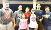 Samoana HS wide receiver Ralph Manuma Taufaasau (second from right) with his parents Jane and Wally, brother Edward, and sisters Genesis, Esther, and Megan. Ralph is the next hot thing in college football recruiting, with coaches from UH and WSU expressing strong interest in the Pago Pago native.  [Courtesy photo]