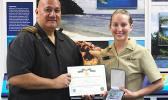 Pictured is LTjg Jarlenski with acting NMSAS superintendent Atuatasi Peau.  [photo: BC]