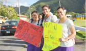These are three students from Nu'uuli Vocational Technical High School (NVTHS) who exercised their right to freedom of speech last Friday, by participating in a wave —calling attention to the school's key need, a gym. [courtesy photo]
