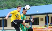 Gabriel Taumua, left, of PagoYouth defends against Utulei Youth's Ne'emia Kaleopa during the men's Cup match of the 2016 FFAS National League's Match Day 4 on Saturday, Sept. 10, at Pago Park Soccer Stadium.