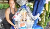 Sales Manager Christa Satele of Pago Pago Trading Company who donated a prize in celebration of the one year anniversary for the Pacific Tires & Auto Parts last Saturday in Tafuna. [Photo: Ese Malala]