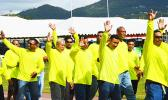 Paramount Builders Inc., workforce marches Friday during the ASG Workforce Day ceremony at Veterans Memorial Stadium in Tafuna. [photo: AF]