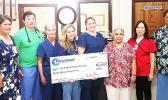 As has been the norm in past years, Paramount Builders donated $12,000 yesterday to the LBJ Medical Center, to help with costs associated with having a team of cardiologists and specialists from the Oregon Health and Science University in the territory this week to treat local youngsters with possible cases of rheumatic fever and those already diagnosed with rheumatic heart disease. Mrs. Wanda Alofa, wife of Paramount Builders owner/ CEO, presented the check to LBJ Chief Executive Officer Faumuina Taufetee