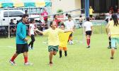 A Pago Youth player of the 7-9 mixed age group celebrates after his team scores a goal on July 4, 2017 during opening day of the FFAS Summer Youth League at Pago Park Soccer Stadium.  [FFAS MEDIA/Brian Vitolio]