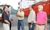 In this Nov. 2010 Samoa News file photo, Tri Marine Managing Director, Joe Hanby, Luen Thai President & COO, Sam H.T. Chou, STP Chief Executive, Ian Boatwood, STP Facility Manager, Craig Double, and Luen Thai Special Projects Executive, Joe Murphy, discuss the rehabilitation of the old SamPac Chicken of the Sea Cannery now Samoa Tuna Processors, on the busy STP dock. Now STP will close indecently in Dec.  Read  story on left. [Photo: Barry Markowitz]