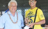 Sam Tualaulelei, a Pago Youth defender, receives his MVP trophy from FFAS President Faiivae Iuli Alex Godinet, left, for the 2016 FFAS National League on Saturday, November 26, 2016.   [FFAS MEDIA/Brian Vitolio]